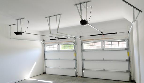 Choisir sa porte de garage construire garage com for Motorisation porte sectionnelle garage