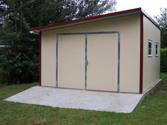 Photos de garages en m tal construire garage com for Petit garage prefabrique