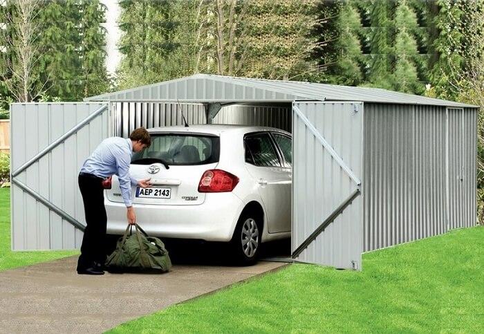photos de garages en m tal construire garage com. Black Bedroom Furniture Sets. Home Design Ideas